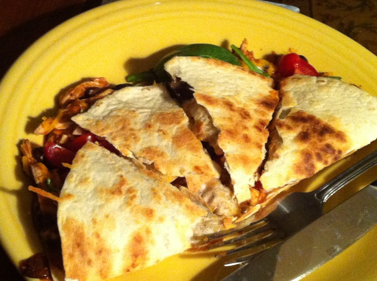 black beans and buffalo sauce. Place tortilla on skillet open faced ...