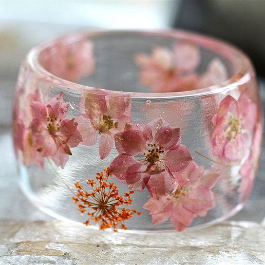 Botanical Bangle. Pink Star Flower/Orange Baby Breath.  Materials: Eco Friendly Resins.  Country of origin: USA