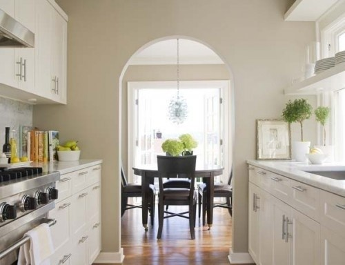 Clean galley kitchen. Like the marble and the white.