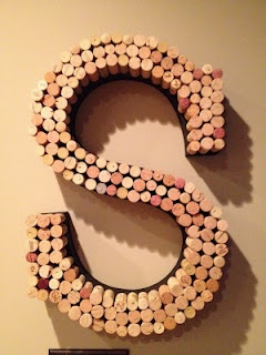 Wine cork letters. Because I have hundreds of wine corks I have no idea what to do with.