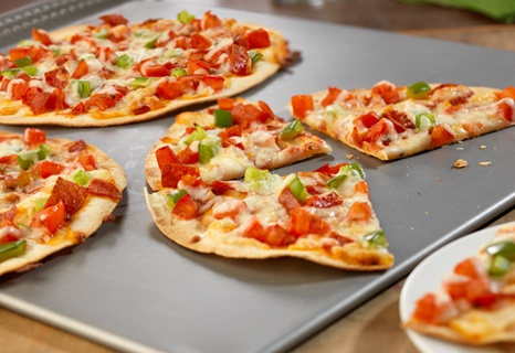 These individual tortilla pizzas, topped with pepperoni, pcante sauce ...