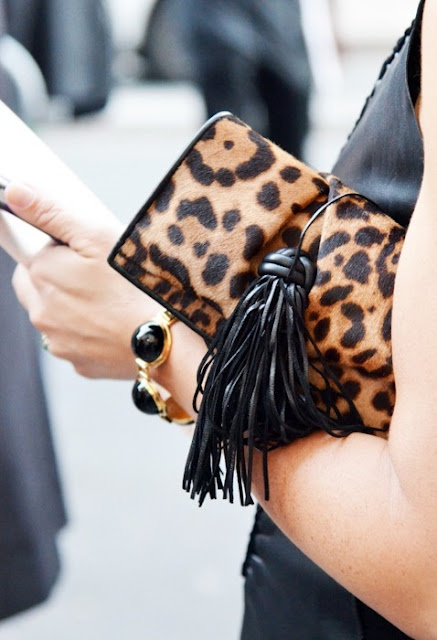 Adore this huge tassel on the leopard print clutch