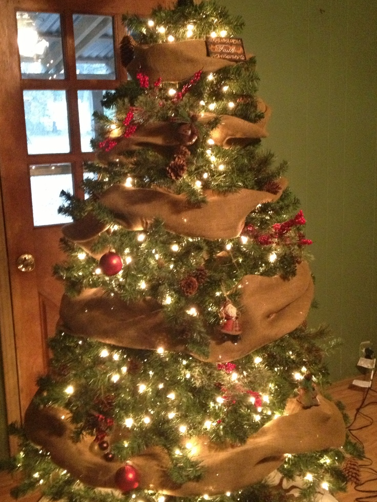 Our christmas tree used burlap hand made pine cone ornaments berry