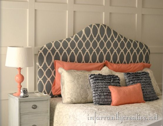 Use a stencil and create your own patterned fabric.  Then make an upholstered headboard that looks like it is out of a catalog.