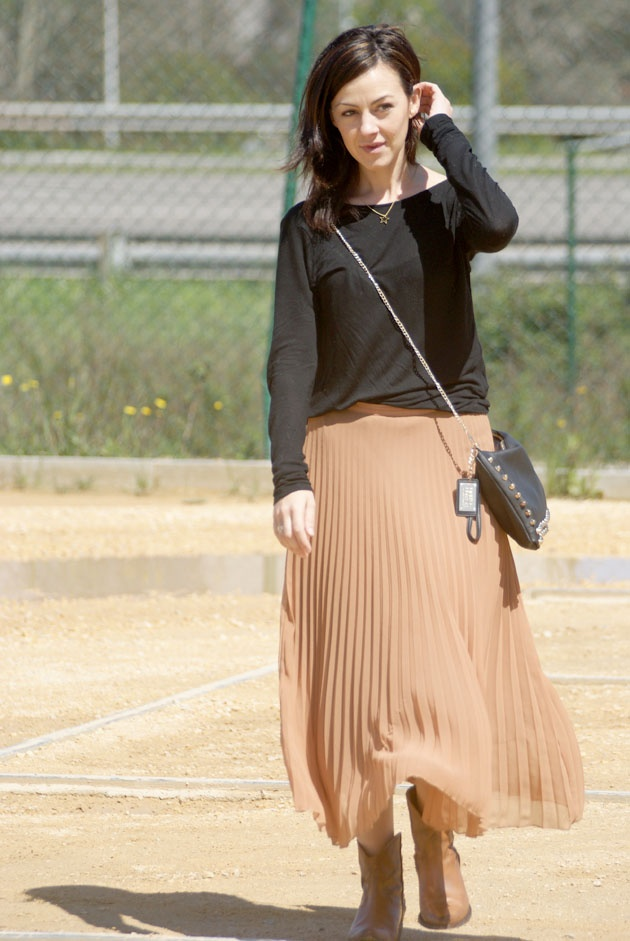 midi skirt and cowboy boots better than a paper sack