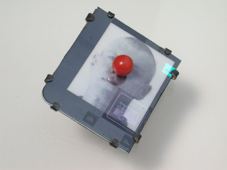 Bernhard  Schobinger  Self-Portrait with Nose (brooch), 2010 - Digital photograph on commuter card, hologram, silver, coral  Courtesy of Gallery S O  Photo courtesy of Gallery S O