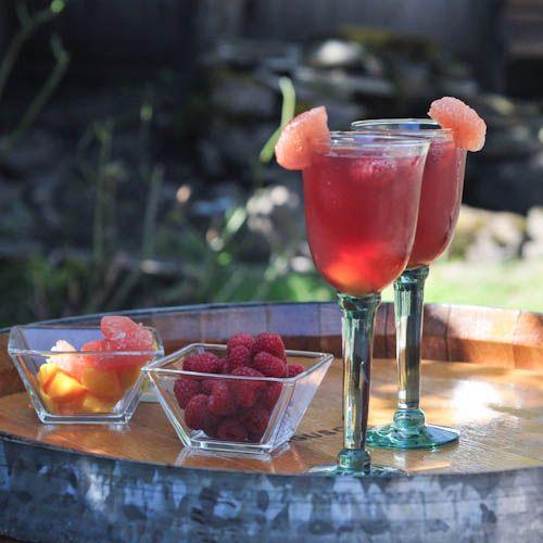 Sangria with raspberries, blueberries, mango, grapefruit