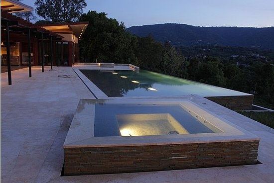 Infinity hot tub swimmingly pinterest for Pool with jacuzzi designs