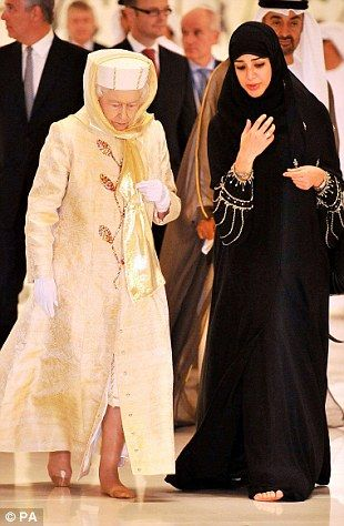 Queen Elizabeth II  walks with a guide in the Sheikh Zayed Grand Mosque in Abu Dhabi, as part of a five-day state visit to the Gulf...