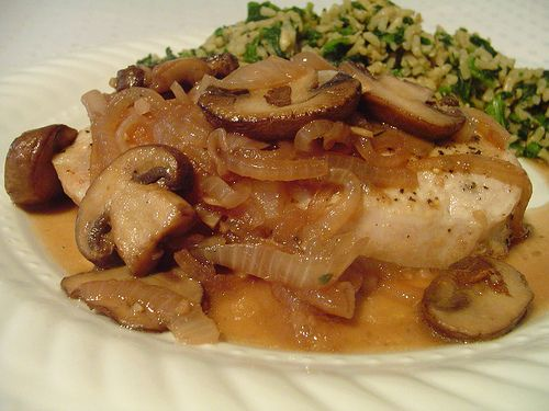 Gouda Stuffed Pork Chop with Caramelized Onion & Mushroom Sauce
