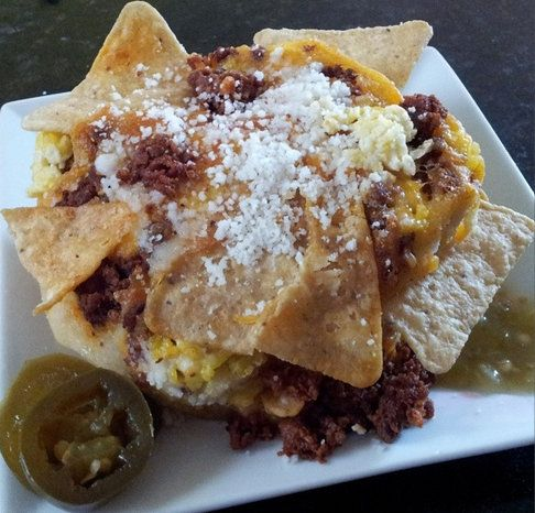... Tortilla Chips and Scrambled Eggs baked in. Topped with cotija cheese