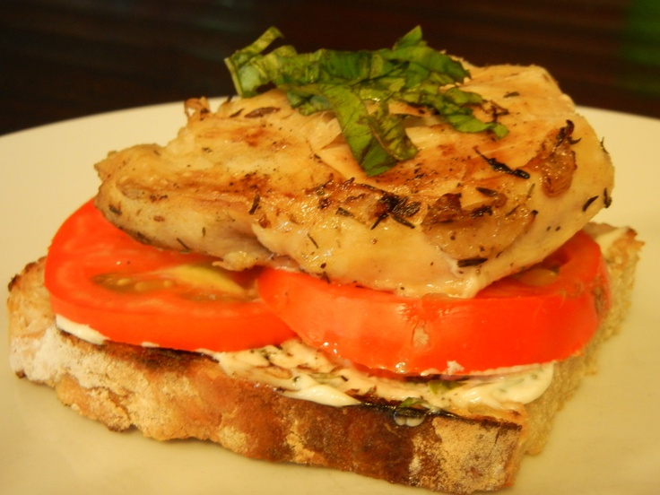 Open faced chicken sandwich with basil mayo.