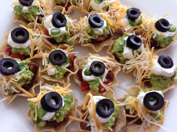 Mini seven layer dip tostadas: refried black beans, drained salsa ...