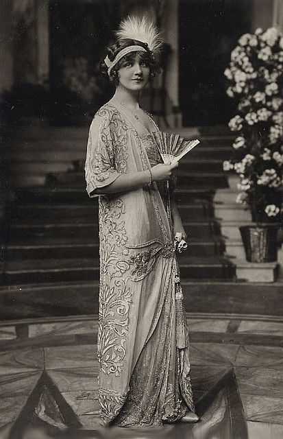 "1910's The original poster indicated this was ""Lily"" and the tags that she was a British actress.  Gorgeous dress."
