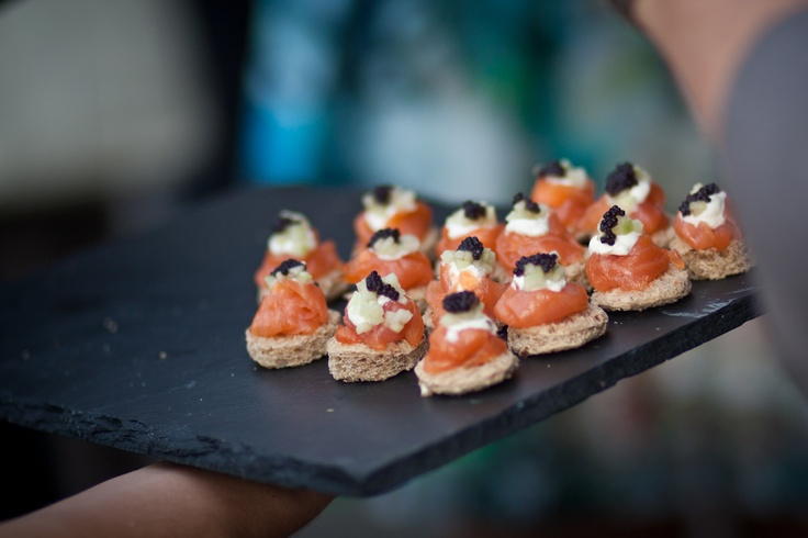 Smoked salmon roulade with sour cream and caviar canapes. Photography ...