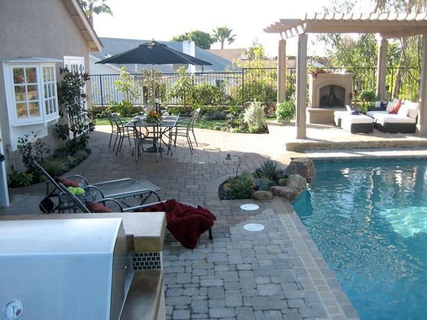 7 amazing backyard makeovers for Backyard makeover with pool
