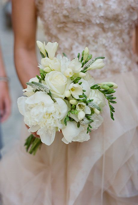 Classic white wedding bouquet with roses and orchids (Photo: Kate Headley)