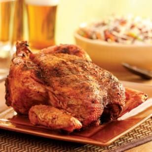 Beer-Barbecued Chicken -- Here's our spin on the roast-a-chicken-on-top-of-a-can-of-beer technique that's popular with barbecue aficionados.
