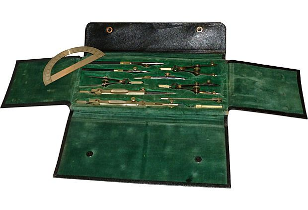 A wonderful set of fine architect's drafting tools in original leather case lined in emerald-green velvet.
