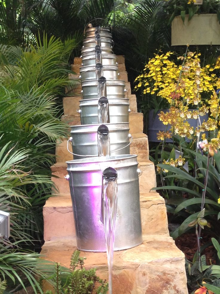 Watering bucket fountain great idea for a cute backyard fountain!!!