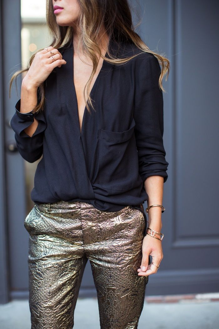 golden pants with black shirt