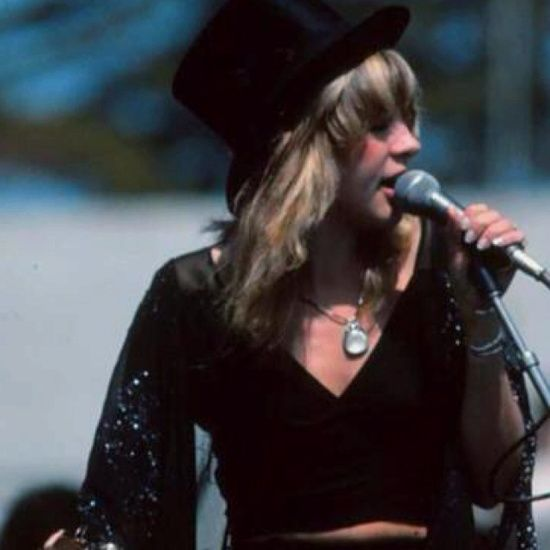 Stevie Nicks wearing her famous top hat and black dresses, mid 70's.