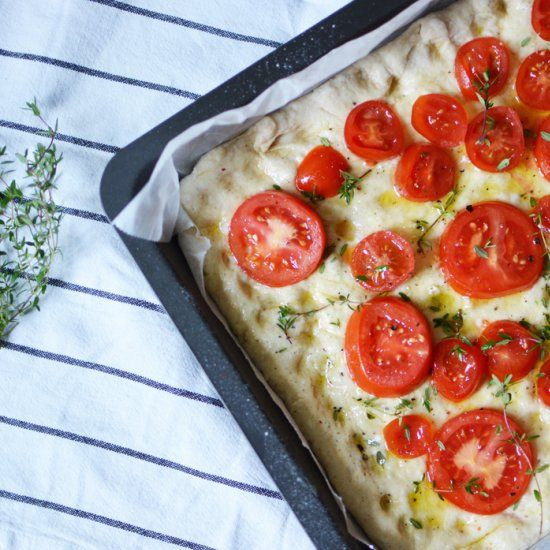 Homemade Focaccia with fresh tomatoes, garlic and thyme. It's really ...