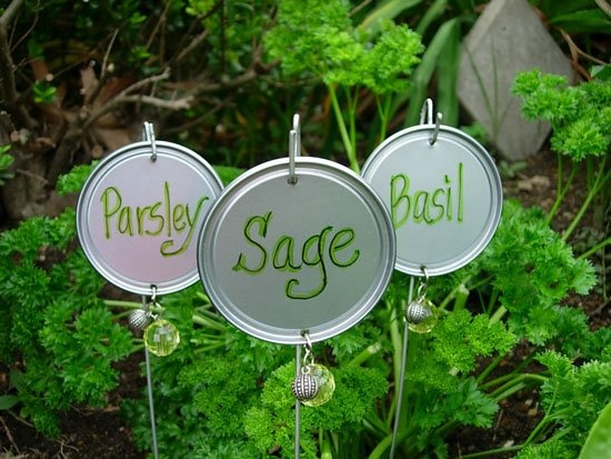These herb labels are made from coat hanger wire and metal tops from frozen juice cans and a few little jewels and bam!*