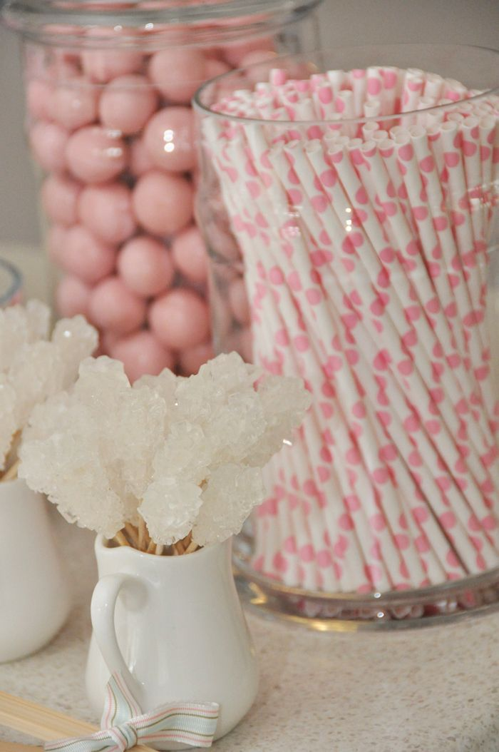 pink and white candy and pink polka dot straws in jars