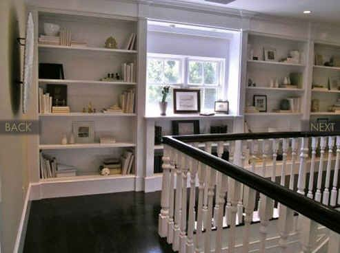 love these shelves at the stair landing and hallway