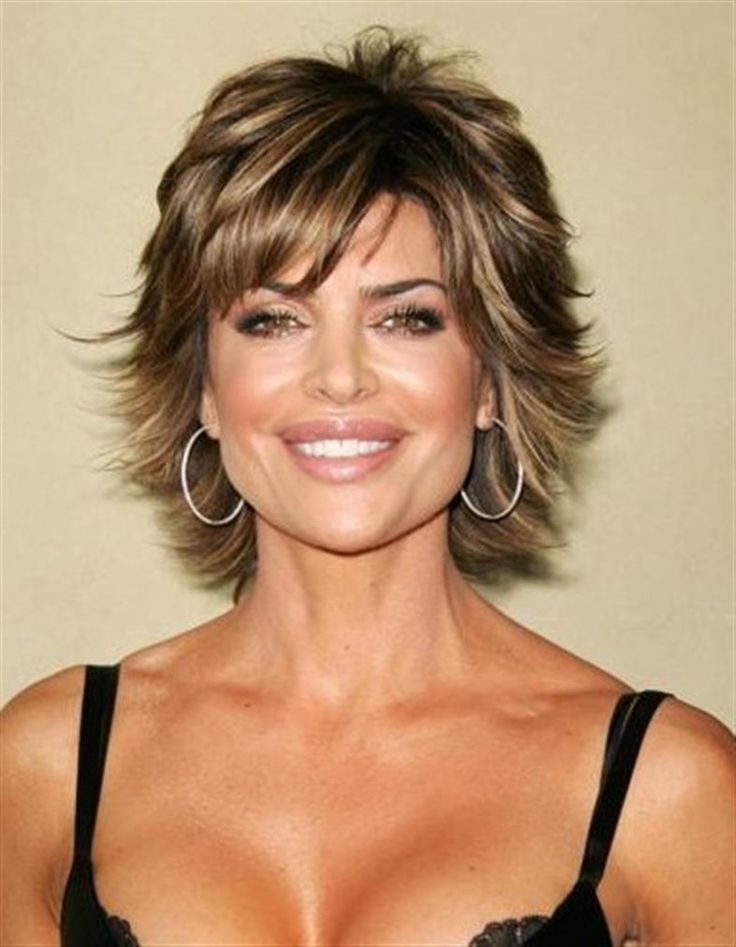 Medium length, short wispy layered, woman's hair cut with side bang