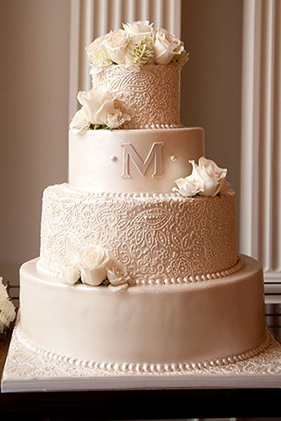 monogrammed wedding cake| Monogram cake toppers have been popular for years, but now, couples are taking their monograms off the top and working them into the cake design instead. Whether hidden in scrollwork or prominently placed on its own tier, adding your monogram is a sweet, sentimental touch.