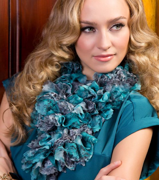 Go wild with this fun teal animal print ruffle scarf!