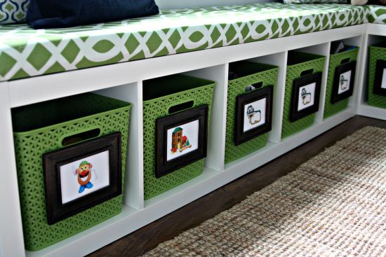 IKEA bookshelf on its side with photo labels.... storage heaven!