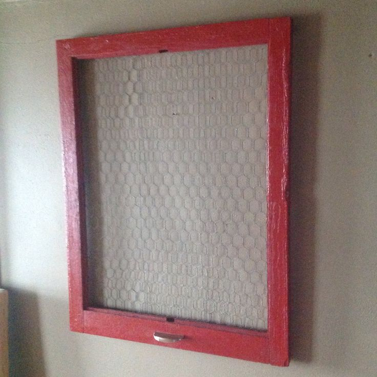 Painted this old window frame red than put chicken wire behind it put