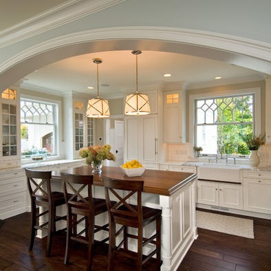 Pendant lights with shades over the island.