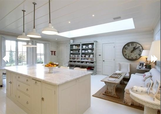Love the feel of this kitchen.  The sitting area is perfect.