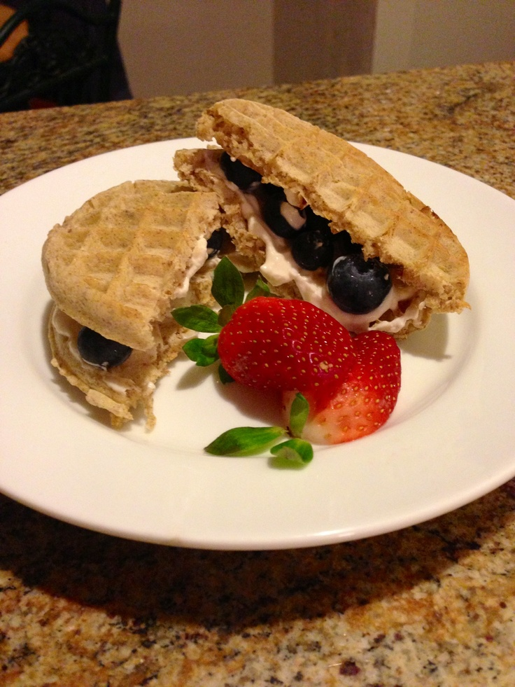 Warm whole wheat waffles with honey vanilla Greek yogurt and fresh ...