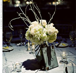 Winter centerpiece flower w branches nat s winter wonderland weddi