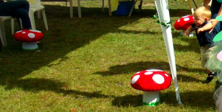 Toadstools. Made out of upside popcorn bucket, red, green and white felt & pillow stuffing. They now are decorations in her room!