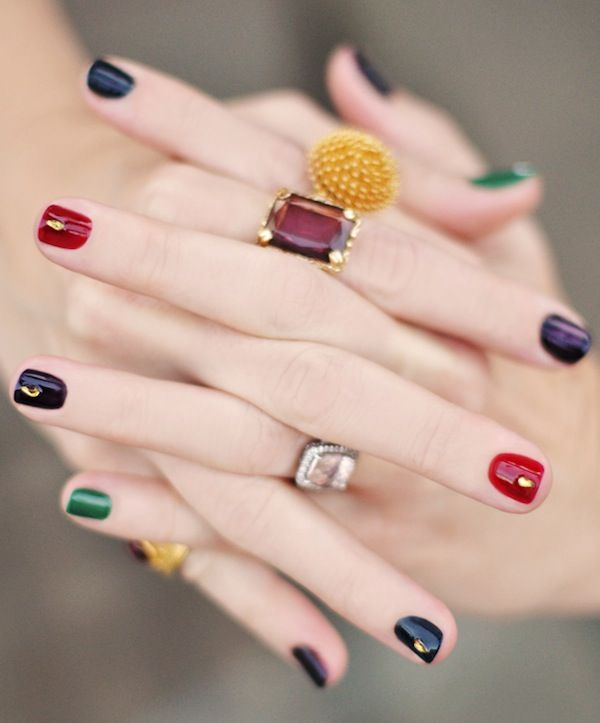 Jewel tone nails with jewels manicure.