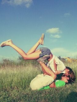 head over heels... @Tara Rogers, this so looks like you and Steven :)  What a cute engagement picture!