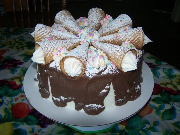 Cake - This cake has Ice Cream Cones filled with frosting, melted ...
