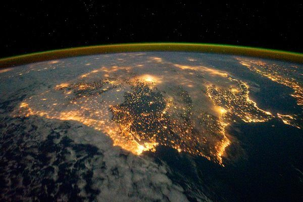 This photograph from space shows airglow, a faint green arc seen along the horizon that's caused by chemical reactions among the gas molecules of Earth's upper atmosphere. Iberian Peninsula from the International Space Station