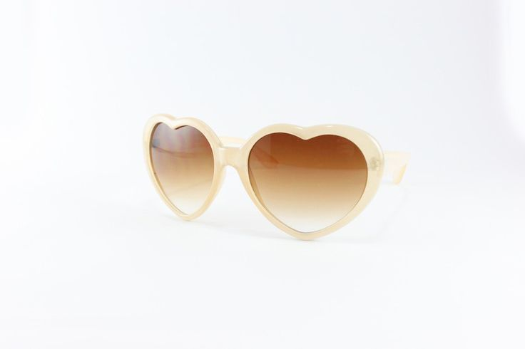 I almost wish I had less-than-perfect vision so I could buy these and put prescription lenses in them, seriously it's one of my life goals to wear real heart-shaped glasses