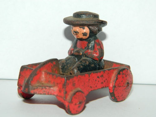 Antique cast iron toy red wagon with little boy rider 311 stamp on