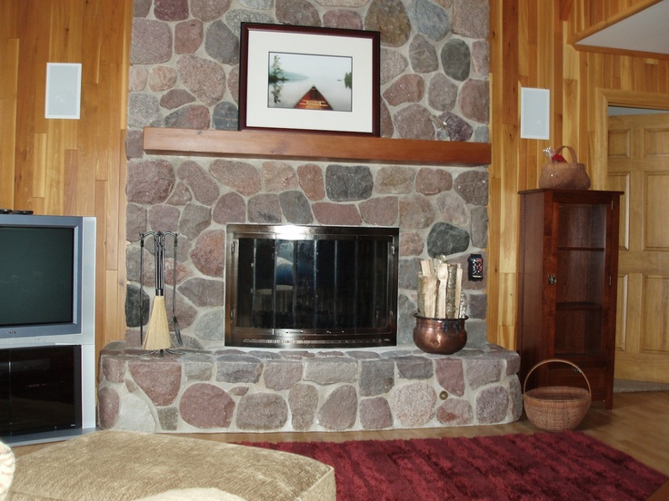 This is an example of a natural split stone fireplace. It provides a clean look and yet rustic enough for a North Woods cabin. As with all of our homes it is such a pleasure to build them and work with the homeowner throughout the process. Thank you for visiting our boards!