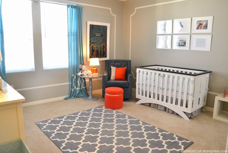 This nursery is clean and modern, yet has a classic look. Love the gray and navy color scheme with pops of orange! #nursery