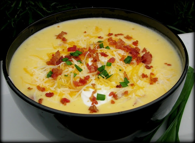 Loaded Potato Soup. Creamy soup made with velveeta cheese and topped ...