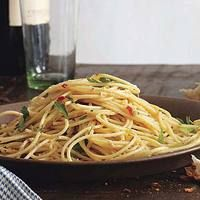 Spaghetti Aglio e Olio  --  this has been my signature dish for ten years. Tyson calls it Garlic Pasta and requests it weekly. My recipe is from a Rachael Ray cookbook (one of her first), but it is a bit different from this one - I'll have to try the ladle-ful  of water trick...